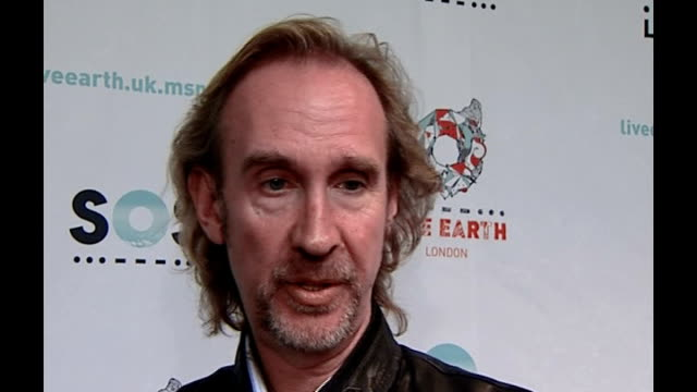 live earth concerts take place around the world; int mike rutherford interview sot - all about raising global awareness gary lightbody interview sot... - mike rutherford stock videos & royalty-free footage
