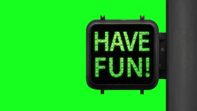 live life. have fun!—chroma key shot of green walk signal with hopeful phrase with green screen in the background - green light stock videos & royalty-free footage