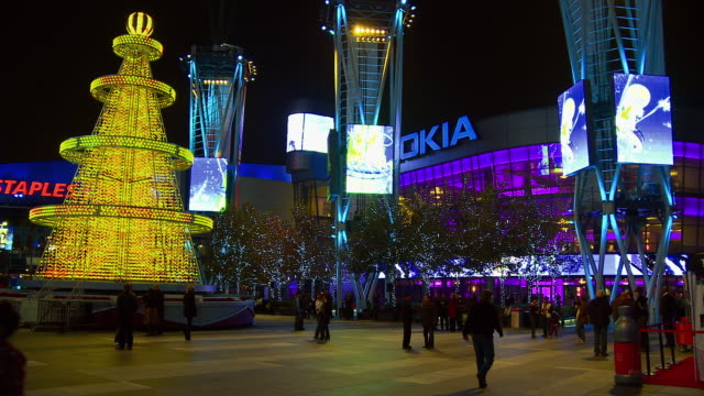 WS, L.A. Live main plaza with giant LED lighted Christmas tree at night, Los Angeles, California, USA,