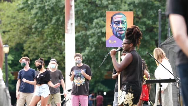 live music and nightly speeches in mccarren park before the march through the streets of williamsburg as bystanders watch. the 55th night of the... - hipster person stock videos & royalty-free footage