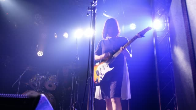 live rock band show in tokyo japan - guitar stock videos & royalty-free footage
