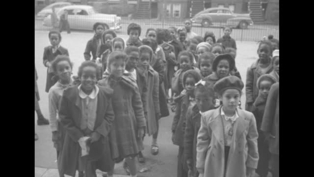 lively africanamerican children at the entrance to an unidentified school building / note exact day not known - jim crow laws stock videos & royalty-free footage