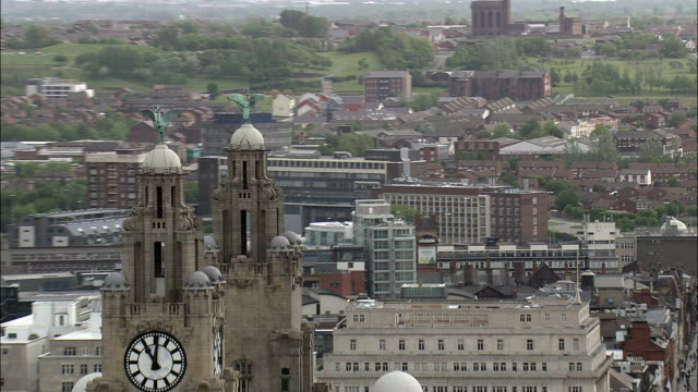 liver birds as part of the three graces buildings  - aerial view - england,  liverpool,  helicopter filming,  aerial video,  cineflex,  establishing shot,  united kingdom - liverpool england stock videos & royalty-free footage