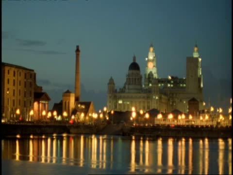 T/L Liver Building and Canning Docks, Liverpool - water reflecting street lights and Liver Building on skyline, night falls