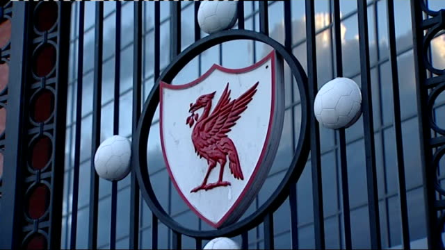 Liverpool Anfield EXT Liverpool FC logo on gates to club and sign for 'The Kop' behind gates