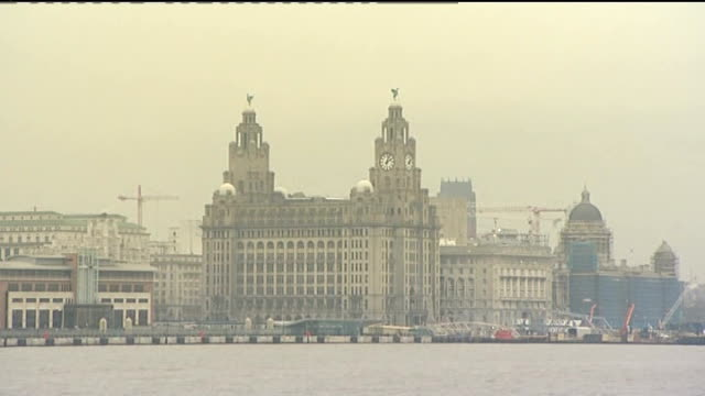liverpool begins year as european capital of culture; england: merseyside: liverpool: ext mersey ferry across river mersey and ray baker interview... - mersey ferry stock videos & royalty-free footage