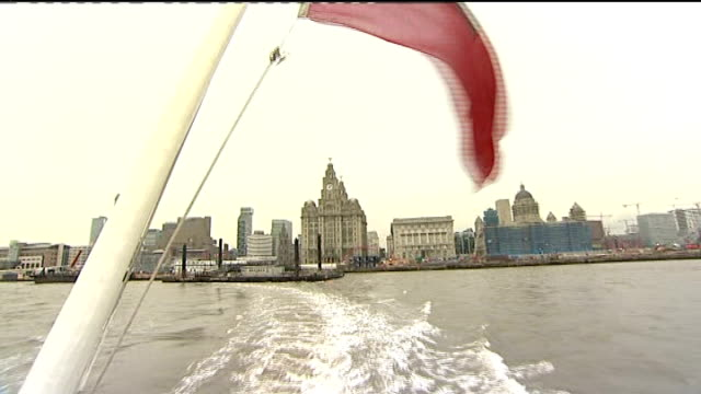 liverpool begins year as european capital of culture; music overlay: gerry and the pacemaker: ferry across the mersey: liver building and albert dock... - mersey ferry stock videos & royalty-free footage