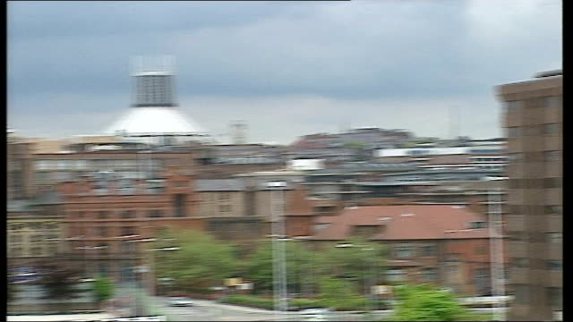 City views ITN ENGLAND Liverpool EXT Liver bird on top of Liver Building / Liverpool Cathedral PAN across showing Liverpool fans lining streets...