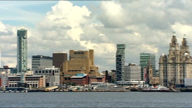 city skyline including liver building, liverpool echo arena and new building projects, includes ferry along mersey - mersey ferry stock videos & royalty-free footage