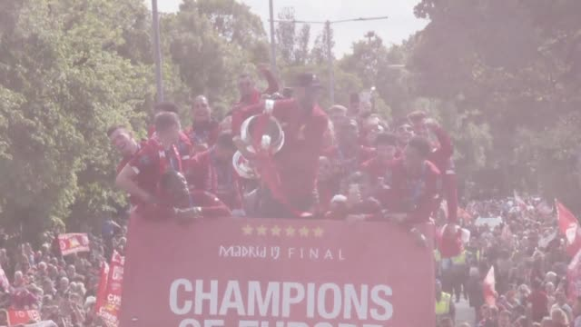 liverpool coach jurgen klopp and his players celebrate the champions league title with their fans on sunday holding a trophy parade through the city - trophy stock videos & royalty-free footage