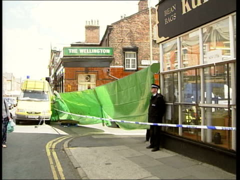 lib england liverpool lms police officer on duty outside cordoned off pub 'the wellington' lms ms forensic officers at scene - merseyside stock videos and b-roll footage