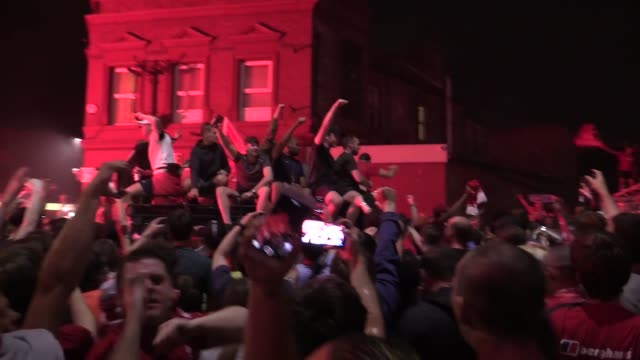 liverpool fans continue their celebrations into the early hours. they gather outside the kop end of the stadium after liverpool's historic premier... - history stock videos & royalty-free footage