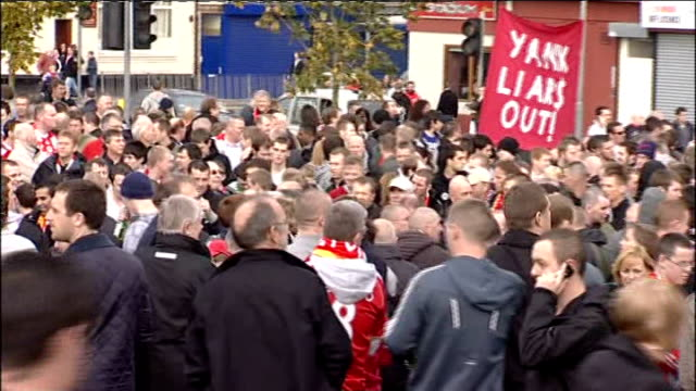Liverpool fans protest against US owners Supporters gathered outside Liverpool Supporters' Club offices/ Crowd of supporters gathered on grassland...