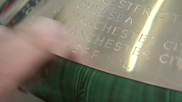 liverpool fc being engraved onto the premier league winners trophy - cup stock videos & royalty-free footage