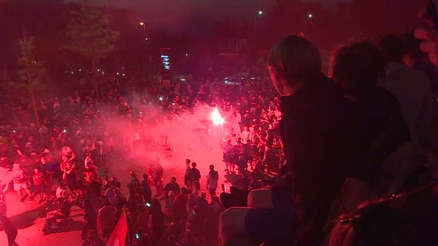 liverpool fc fans celebrating outside anfield stadium, after they become premier league champions for the first time in 30 years - sports team stock videos & royalty-free footage