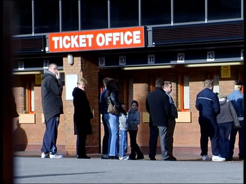 gerard houllier future itv england liverpool anfield fans queuing at ticket office ms liverpool emblem on gates gv liverpool stadium seen thru gates - itv late news stock-videos und b-roll-filmmaterial