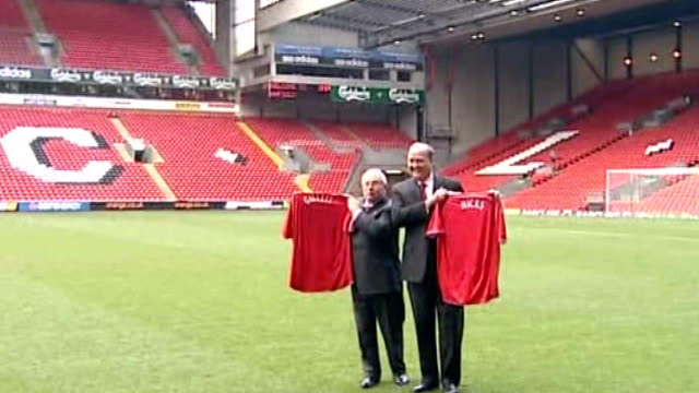 owners' legal ruling 'thrown out' by high court r06020704 liverpool anfield george gillett and tom hicks posing with football shirts on pitch at time... - time of day stock videos and b-roll footage