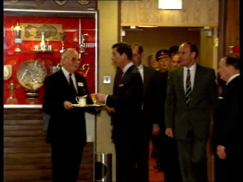 liverpool fc prince charles visit int lms charles enters trophy room zoom in as stands by man holding tray with glass of orange juice and bbc jug... - jug stock videos & royalty-free footage