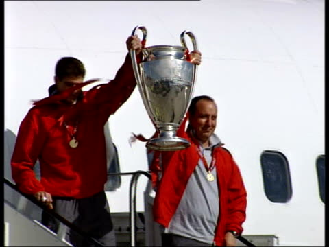 Liverpool FC return after Champions League victory airport arrival/ parade ENGLAND Liverpool John Lennon Airport EXT EasyJet plane taxiing plane on...