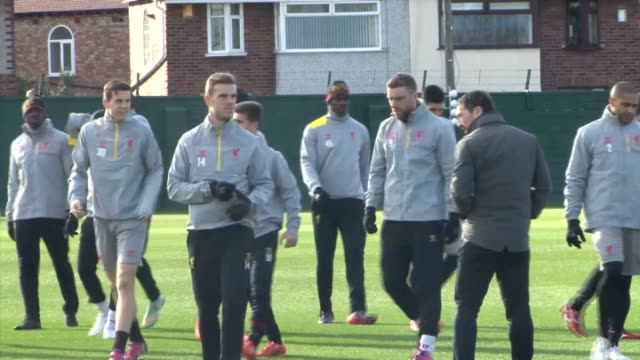 Liverpool EXT Various of Liverpool FC players training in the build up to the UEFA Europa League match v Beskitas watched by Manager Brendan Rodgers...
