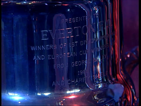 liverpool: goodison park: trophy in cabinet tilt down european cup- winners cup pennant trophy trophies on display michael dunford interview sot -... - display cabinet stock videos & royalty-free footage