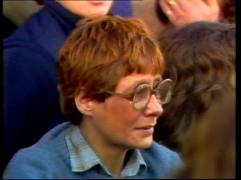 john lennon tribute; england, liverpool tbv crowd pull back outside st georges hotel slogan held pull back woman weeping as sings cms t-shirt with 'j... - john lennon stock videos & royalty-free footage