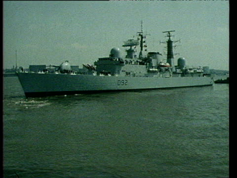 hms liverpool leaving merseyside crew standing on deck of ship city in background falkland conflict 10 may 82 - marine stock-videos und b-roll-filmmaterial