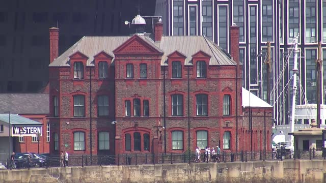 liverpool loses its status as a unesco world heritage site over dockland developments; england: liverpool: ext councillor sarah doyle interview sot... - clock tower stock videos & royalty-free footage