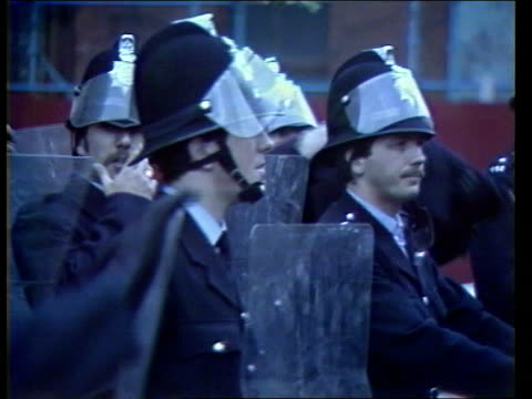 Liverpool Toxteth DUSKGV Metropolitan policeMS Police group in formationCMS Ditto helmets with visors