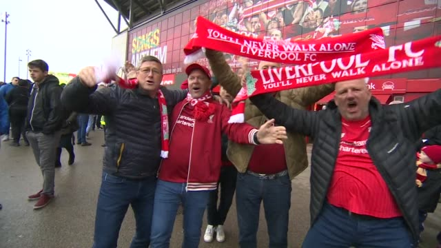 liverpool supporters outside anfield before their premier league match against huddersfield - huddersfield town football club stock videos & royalty-free footage