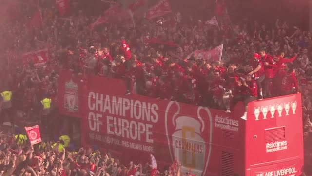 liverpool supporters turn the city into a sea of red as the open top bus carrying coach jurgen klopp and his victorious players edge through - bus stock videos & royalty-free footage