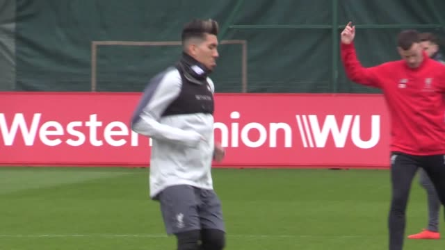 Liverpool train ahead of their Champions League quarterfinal match against Porto Footage includes manager Jurgen Klopp and players Sadio Mane Mohamed...
