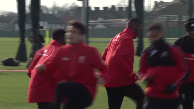 liverpool melwood ext players out onto training pitch / cus simon mignolet / cus christian benteke / team along for jog / team stretches and warm up... - liverpool england stock videos & royalty-free footage