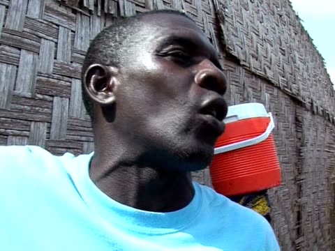 living and fishing on the fringe of liberia's atlantic coast is a risky business. in the town of buchanan, homes and livelihoods are being devoured... - erodiert stock-videos und b-roll-filmmaterial