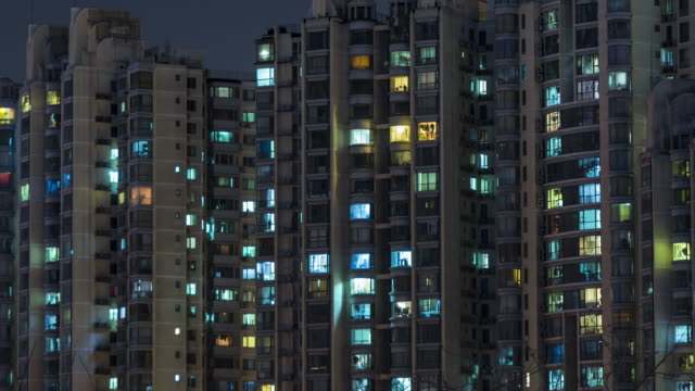 t/l ms ha tu living apartment, residential building at night / beijing, china - population explosion stock videos and b-roll footage