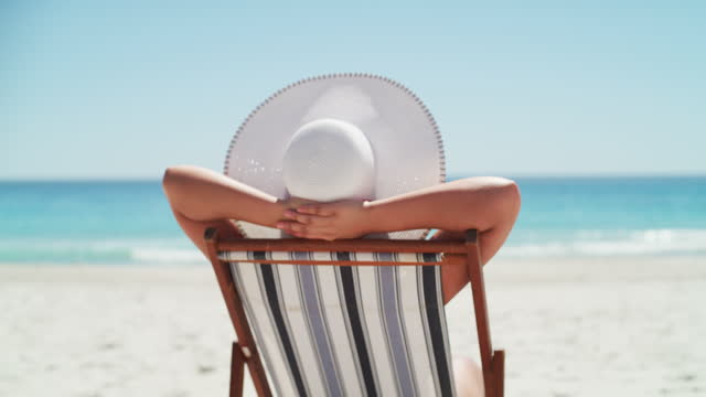 living life at the pace of the tide - deckchair stock videos & royalty-free footage