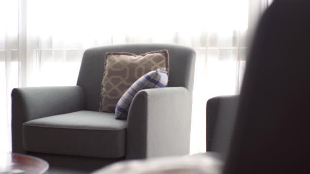 living room modern bright interior - sofa stock videos & royalty-free footage