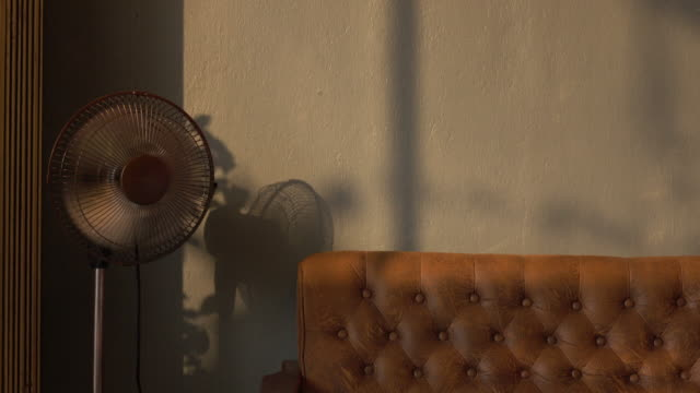 Living room with retro sofa and electric fan