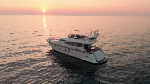 living the good life - watching the sunset from a luxury yacht - yacht stock videos & royalty-free footage