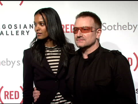 Liya Kebede and Bono at the Bono and Damien Hirst Paint the Town Red For Aids In Africa The Auction at Sotheby's in New York New York on February 14...