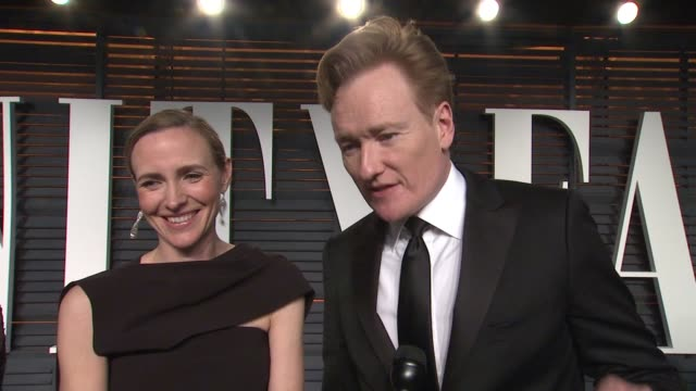 interview liza powel and conan o'brien at the 2015 vanity fair oscar party hosted by graydon carter at the wallis annenberg center for the performing... - wallis annenberg center for the performing arts stock videos and b-roll footage