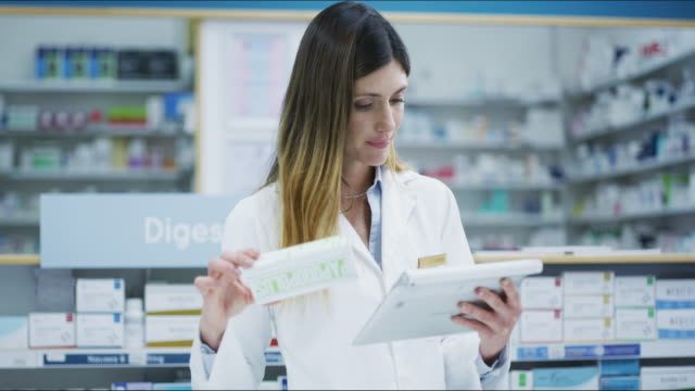 i'll get all the info online for this new product - pharmacist stock videos & royalty-free footage