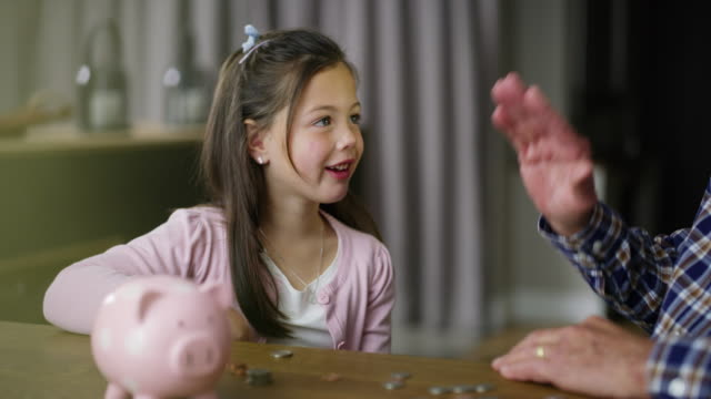 i'll save up to buy a pony - piggy bank stock videos & royalty-free footage
