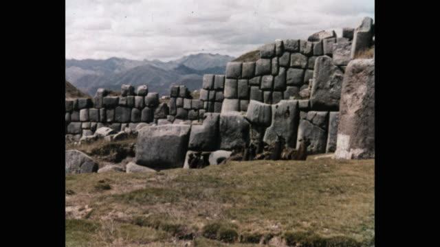 llamas headed along monolithic incan wall, peru - ancient stock videos & royalty-free footage
