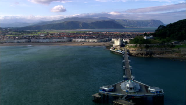 llandudno and pier - aerial view - wales, county borough of conwy, conwy, united kingdom - victorian stock videos & royalty-free footage