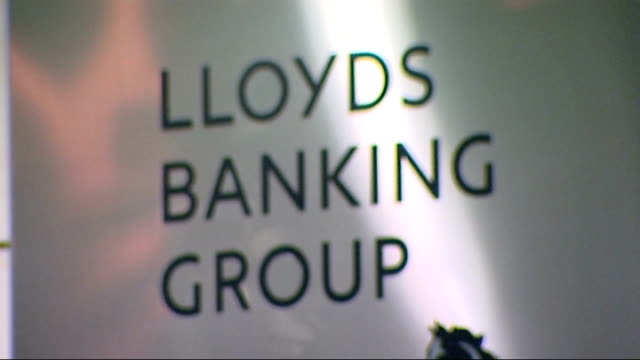 lloyds bank to close hundreds of branches; r09021109 / 'lloyds banking group' sign - banking sign stock videos & royalty-free footage