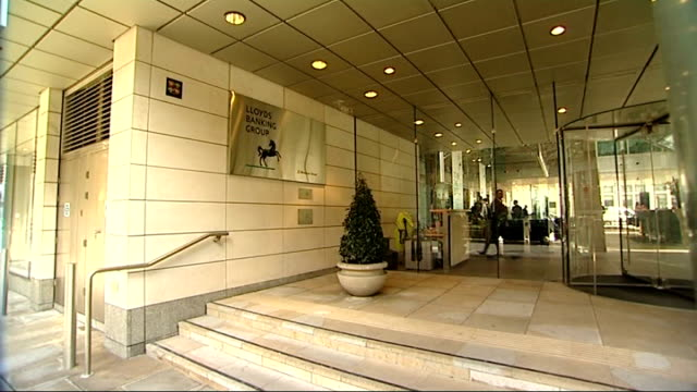 ext lloyds banking group sign outside building - banking sign stock videos & royalty-free footage