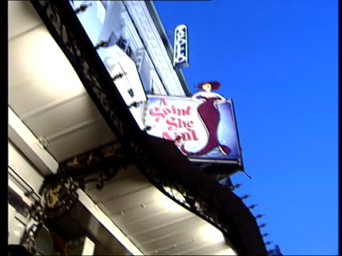 London Shaftesbury Avenue SEQ traffic along theatres FOCUS 'Stoll Moss Theatres' sign DUSK GV people standing outside theatre TILT UP 'Apollo' sign...