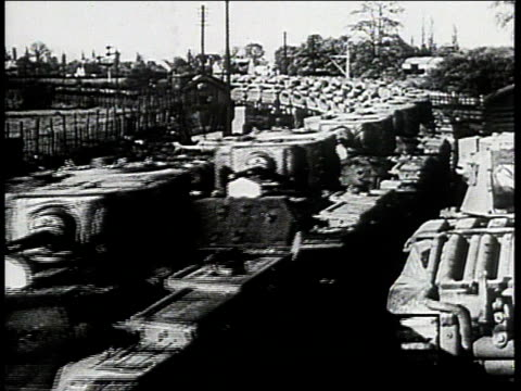 vídeos de stock, filmes e b-roll de load of tanks being transported by train and offloading upon arrival / united kingdom - 1943