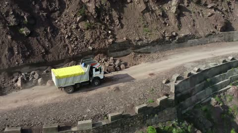 loaded truck driving on a risky mountain road, approaching leh, jammu & kashmir, india - commercial land vehicle stock videos & royalty-free footage